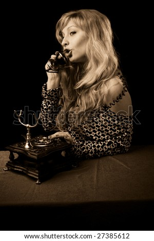beautiful caucasian woman talking on retro phone.