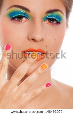 Beautiful caucasian woman with bright artistic makeup on a white background