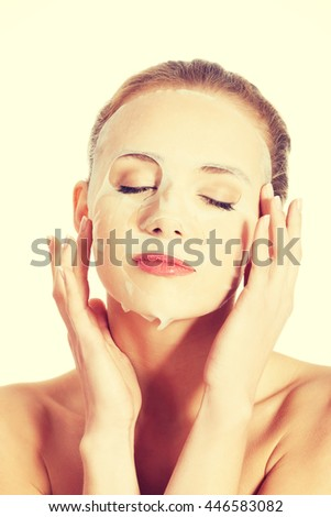 Beautiful caucasian woman with collagen mask. - stock photo