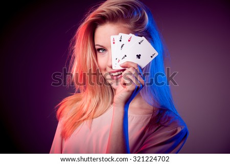 Beautiful caucasian woman with poker cards gambling in casino  - stock photo