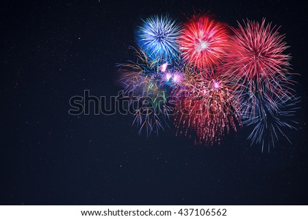 Beautiful celebration fireworks over starry sky, copy space.  Independence Day, New Year holidays salute. 4th of July beautiful fireworks. Canada Day Holidays background. - stock photo