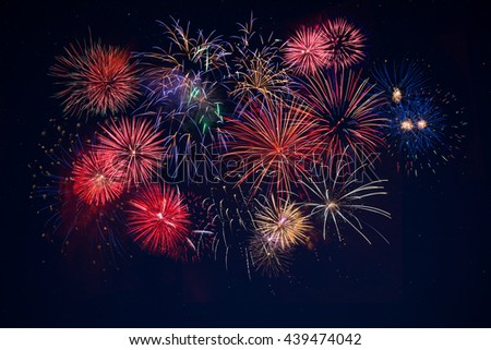 Beautiful celebration golden, red, blue sparkling fireworks over starry sky. Holidays symbol background. Independence Day, 4th of July holidays salute. New Year beautiful fireworks.  - stock photo