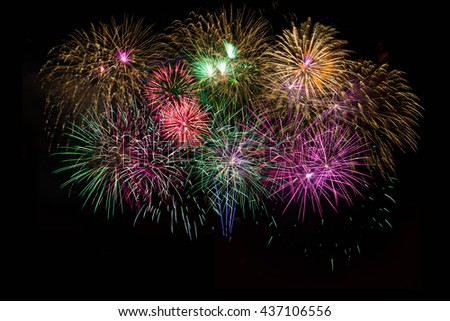 Beautiful celebration golden, red, purple, green sparkling fireworks.  Independence Day, 4th of July holidays salute. New Year beautiful fireworks. Canada Day Holidays symbol background. - stock photo