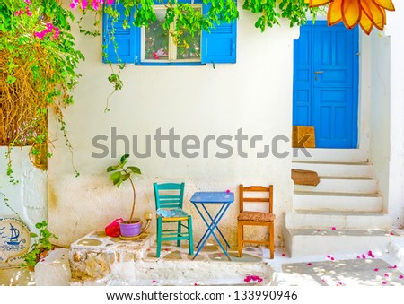 Beautiful chairs and a table out of a house in Langada a village of Amorgos island in Greece - stock photo