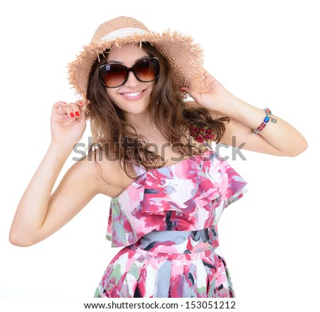 Beautiful cheerful confident young woman in sunglasses and straw hat, over a white background  - stock photo