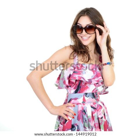 Beautiful cheerful confident young woman standing with arms behind head over a white background - stock photo