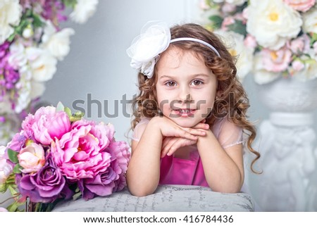 Beautiful cheerful girl four years old  - stock photo