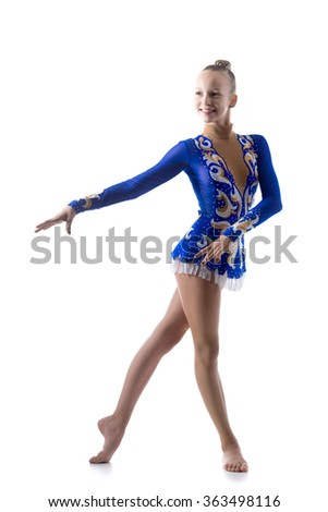 Beautiful cheerful teenage fit ballerina girl wearing dancer blue leotard working out, dancing, posing, doing rhythmic gymnastics exercise, full length, studio, white background, isolated - stock photo