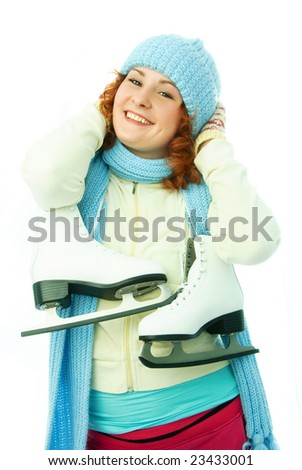 beautiful cheerful young woman dressed in warm winter clothes goes ice-skating - stock photo