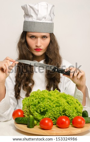Beautiful chef preparing a green salad for a perfect healthy life