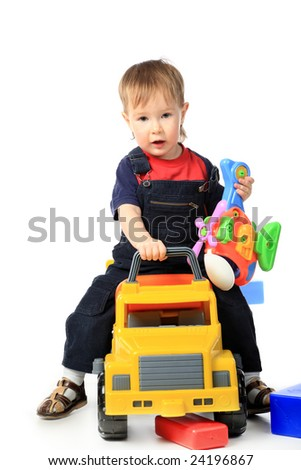 Beautiful child enjoying his game. Shot in a studio. - stock photo