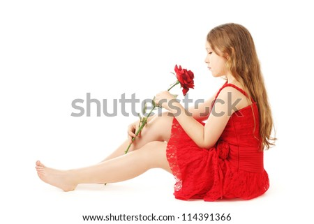 Beautiful child girl with red rose. Pretty child 10 years old with flower isolated on white