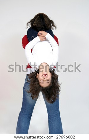 beautiful child playing with mom - stock photo