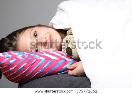 Beautiful child sleeping in bed