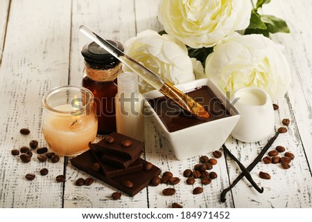 Beautiful chocolate spa setting on wooden table close-up - stock photo