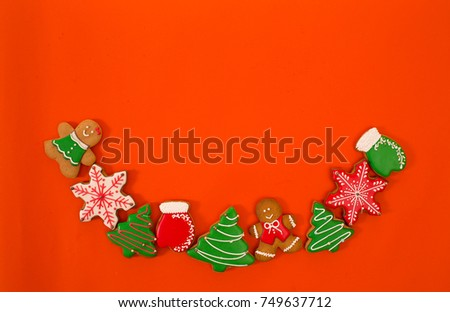 Beautiful christmas background, ginger cookies in bright red background