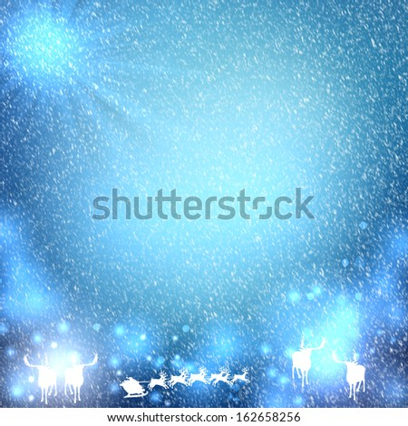 Beautiful Christmas background with reindeer and place for text. - stock photo