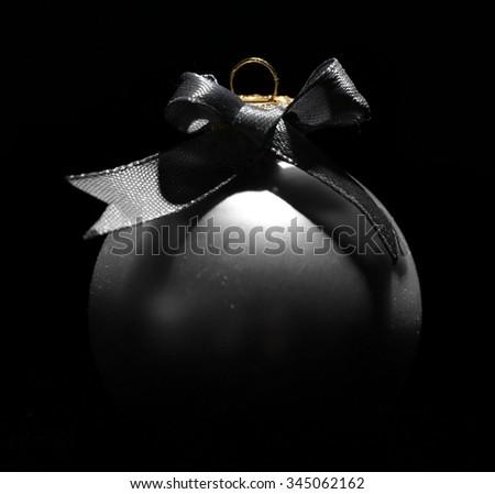 Beautiful Christmas ball on black background - stock photo