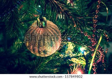 Beautiful christmas ball on xmas tree  - stock photo