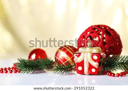Beautiful Christmas balls on light blurred background