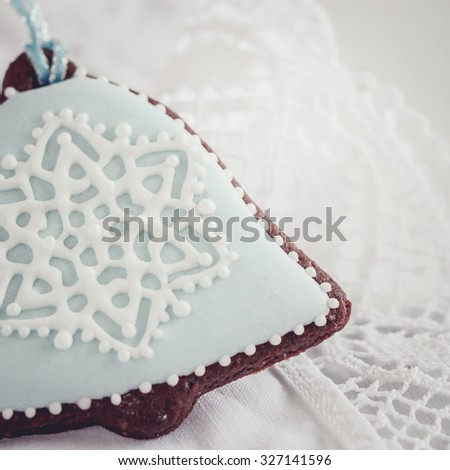 Beautiful christmas bell cookie decorated with icing snowflakes, selective focus - stock photo