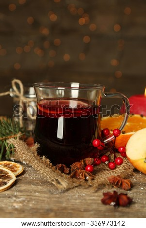 Beautiful Christmas composition of mulled wine on decorated wooden table, close up - stock photo