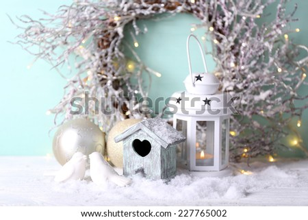Beautiful Christmas composition with small bird house - stock photo