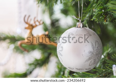 Beautiful Christmas decor on green Christmas tree. - stock photo