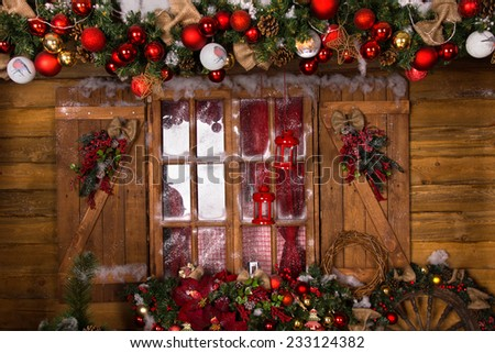 Beautiful Christmas Decoration with Assorted Ornaments at Glass House Window with Wooden Frame. - stock photo