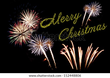Beautiful Christmas fireworks on the black sky background
