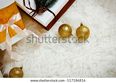 beautiful Christmas gift boxes with decorations in new year interior