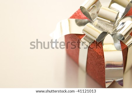 Beautiful Christmas gifts on a silver background - stock photo