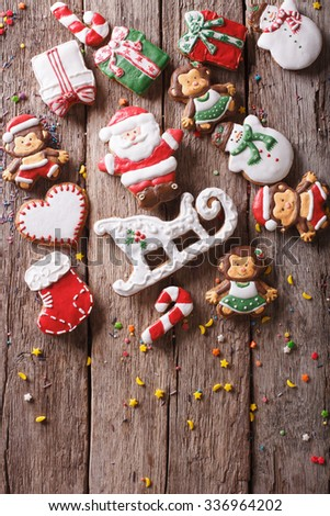 Beautiful Christmas gingerbread cookies on a wooden table. vertical top view - stock photo