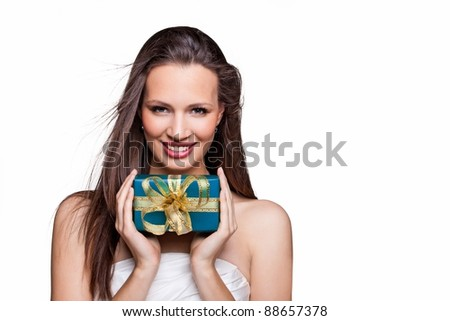 Beautiful christmas girl with gift box - stock photo