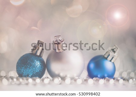Beautiful Christmas globe decorations with lights and snowflakes.