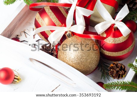 Beautiful christmas red and golden balls with tapes and decorations.