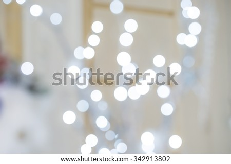 Beautiful Christmas Silver Lights. Defocused background - stock photo