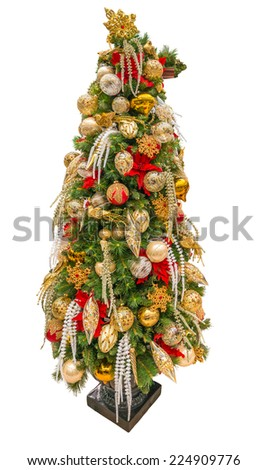 Beautiful christmas tree decorated and lighted with gifts and ornaments for Christmas and for New Year Eve.  Isolated on white. - stock photo