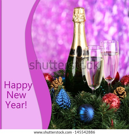Beautiful Christmas wreath in composition with champagne on purple background - stock photo