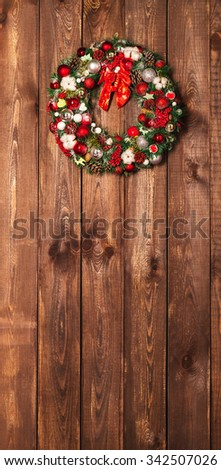 Beautiful Christmas wreath on the wooden background - stock photo