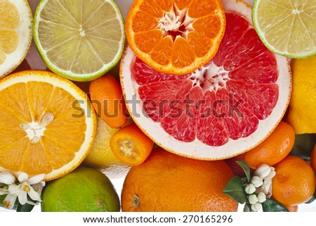 Beautiful citrus fruits mixed close up  top view background - stock photo