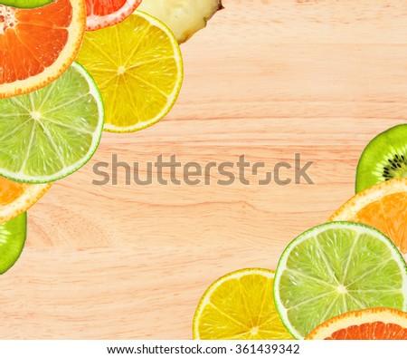 Beautiful citrus fruits of lemon, orange, grapefruit, lime on wooden table background - stock photo