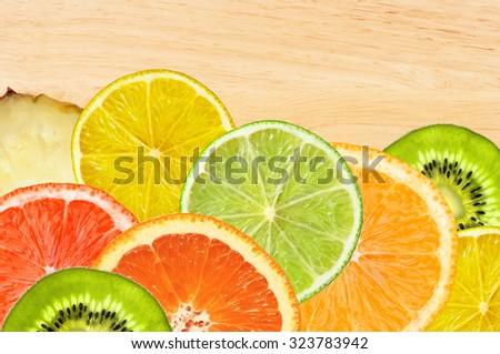 Beautiful citrus fruits of lemon, orange, grapefruit, lime on wooden texture close-up - stock photo