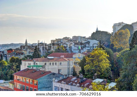 Beautiful city view of Istanbul with colorful houses / Istanbul / autumnal evening atmosphere