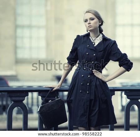 beautiful city woman has walking on a street - stock photo
