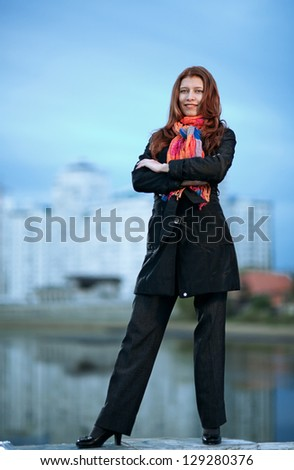 beautiful city woman stand  on a street - stock photo