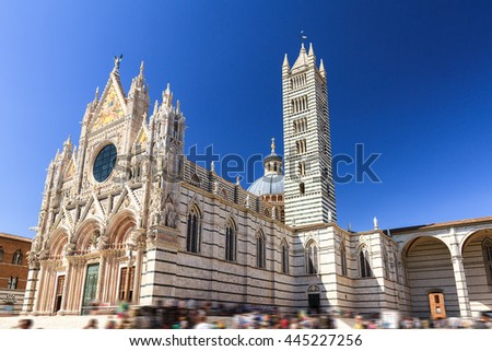 Beautiful cityscape of Siena, Italy, with the Siena Cathedral (Duomo di Siena) with a blue sky in summer