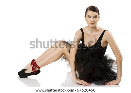 beautiful classic dancer girl sitting on white with black dress and shoes and looking in camera - stock photo