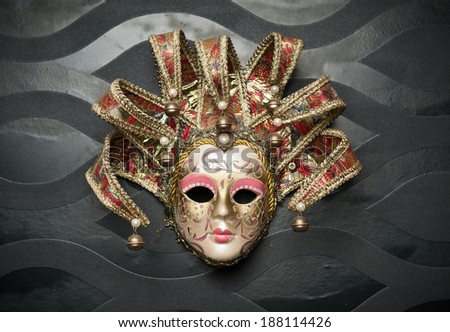 Beautiful classical mask from  Venice on black wall. Carnival mask. Venetian tradition   - stock photo