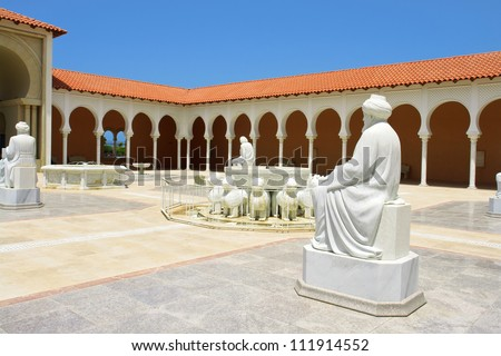 Beautiful Classical Mediterranean Hacienda Spanish style building with stone arches - stock photo